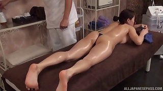 Asian beauty with a hot body gets an oiled rubdown