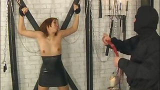 Asian girl tied up during a kinky BDSM session with a horny man