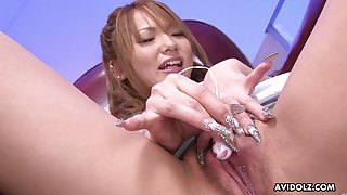 Giggling lovely fresh Japanese cutie tickles her wet pussy